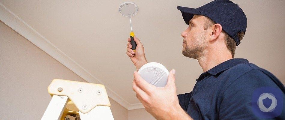 Man installing a smoke detector